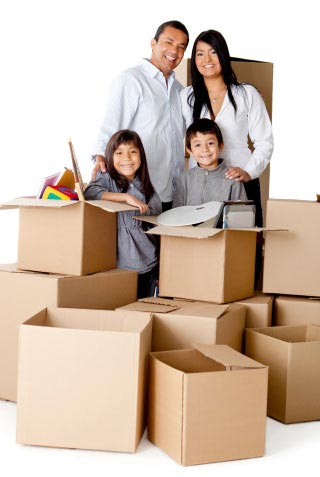 family with boxes ready to move